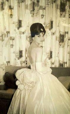 All ready for her senior prom. She looks a little bit like Audrey Hepburn. Circa 1960