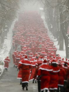 SANTA STAMPEDE!Hundreds of people dressed as Santa Claus start the annual St. Nicholas Run, in Michendorf, Germany