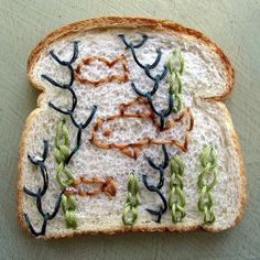embroidered bread by Catherine McEver........my question is why?...why would you embroider bread?!!!