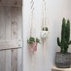 This macrame plant hanger is handmade with neutral cotton macrame cord and has a nice and sturdy ring for hanging. The plant hangers… Macrame Plant Holder, Plant Holders, Metal Plant Hangers, Pot Hanger, Deco Boheme, Macrame Cord, Hanging Planters, Plant Decor, Pots