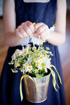 Flower girl basket. Do you think the church will mind if we drop daisies in the aisle?