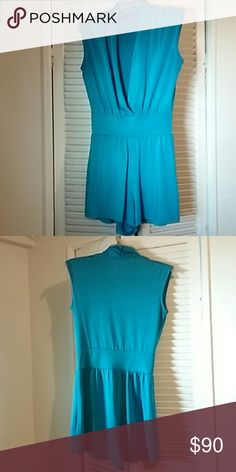 Romper Silk blue low cut romper. Size small or medium for tighter fit. Shorts to upper thigh. Only worn twice. Bought at a boutique in Miami for $130, selling for $90. Other