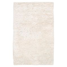 Lend a touch of textured appeal to your living room or master suite with this artfully hand-tufted New Zealand wool shag rug, showcasing a luxe papyrus hue. ...