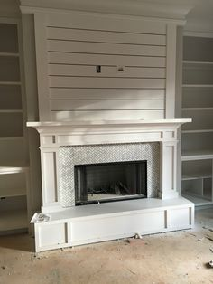 Like the shiplap style above the mantel where the tv would be mounted.