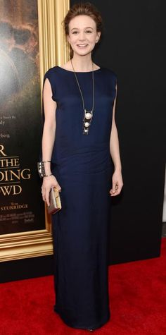 Carey Mulligan pared it down for the Far From the Maddening Crowd screening in head-to-toe Lanvin, selecting an incredibly elegant navy silk crepe column gown, complete with a statement pearl-and-crystal pendant necklace and matching cuff, and a silver python clutch.