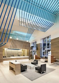 BankUnited | Ceilings + Walls // custom extrusion folds create a signature feature for walls and ceilings, incorporating the brand color and LED lighting // Institutional Engineered Fabricated Custom Powder Coated