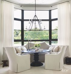 David Iatesta's Leiden chandelier hovers over a Lorraine Refectory table by Gregorius Pineo in the breakfast area. Kasler's Amsterdam side chairs for Hickory Chair pull up to the table, and the console is from Holland & Company in Atlanta.