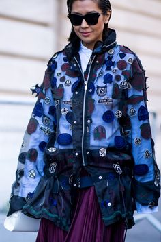 As seen at Paris Fashion Week SS17: badges and crests were the coolest decoration for jackets. This sheer, zip-up jacket is the ultimate option