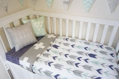 Navy grey and mint arrow nursery set by MamaAndCub on Etsy: