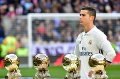 Real Madrid's Portuguese forward Cristiano Ronaldo poses with his four Ballon d'Or France Football trophies before the Spanish league football match Real Madrid CF vs Granada FC at the Santiago Bernabeu stadium in Madrid on January 7, 2017..Real Madrid won 5-0. / AFP / GERARD JULIEN