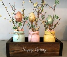 This mason jar centerpiece is perfect for your home or event! Great for weddings, parties and home decor. The wooden planter box measures x 5 and fits 3 pint size mason jars which have been decorations for the home Easter/Spring centerpiece Pot Mason Diy, Mason Jar Crafts, Bottle Crafts, Mason Jars, Mason Jar Planter, Wooden Planter Boxes, Easter Table Decorations, Easter Centerpiece, Spring Decorations