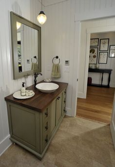 1d19d752fb53 The earthy greens in this guest bathroom vanity and mirror built by  Eastburn Woodworks went perfectly