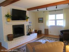 How To Mount a TV on a Brick Fireplace - painted brick AND installing beams for track lighting at roof square? Tv Mount Over Fireplace, Fireplace Update, Brick Fireplace Makeover, White Fireplace, Fireplace Remodel, Fireplace Wall, Fireplace Ideas, Brick Wall Tv, Tv Mounted Above Fireplace