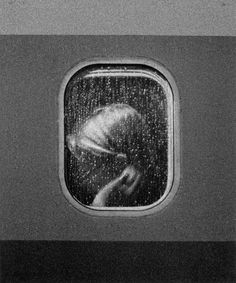 On the plane waiting in the rain