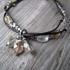 Intertwined Leather and Silver Bracelet with Rutilated Quartz. $66.00, via Etsy.