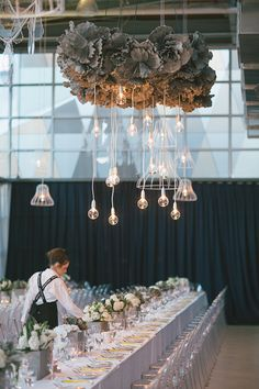 Modern paper flower and lightbulb chandelier.