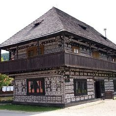 The typical village ČIČMANY surrounded by the mountains Strážovské vrchy and Malá Fatra in the southern part of the valley Rajecká dolina is famous for its original log houses with the typical white ornamentation. Floor Wallpaper, Door Crafts, Heart Of Europe, Interior And Exterior, Interior Ideas, Hotel Lobby, Beautiful Places In The World, Bratislava, Log Homes