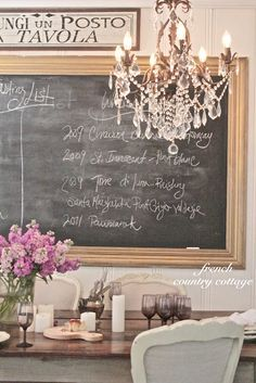 French dining room - chalkboard, crystal chandelier, french chairs