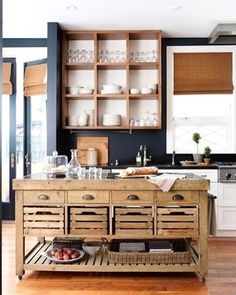 Rustic kitchen island and open shelves