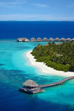 The Dusit Thani Maldives is a spectacular green dot in a sea of blue. This stunning hotel is located on Muhdhoo Island on the Maldives and provides its guest a taste of paradise.
