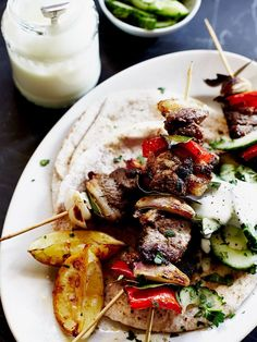 Quick lamb kebabs | Lamb recipes | Jamie Oliver recipes Welsh Cawl, Lamb Kebabs, Lamb Dishes, Kebab Recipes, Beef Recipes, Cooking Recipes, Healthy Recipes, Savoury Recipes, Healthy Dinners