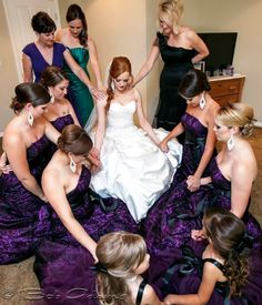 Wedding pictures, bridesmaids, mother, mother-in-law, sister-in-law praying over bride