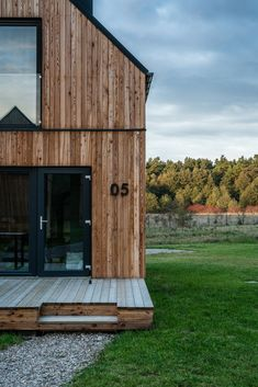 Photo 4 of 17 in These Tiny Cabins in Poland Offer Creature Comforts in the Woods - Dwell Tiny Cabins, Tiny House Cabin, Cabins In The Woods, House In The Woods, Black Metal Roof, Small Cottage Designs, Resort Interior, Small Wooden House, Tiny House Exterior
