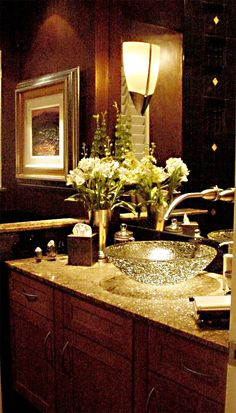Small bathrooms can be glamorous and dramatic. This transitional bathroom works in a myriad of design styles.