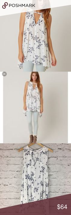 """Free People tree swing tank top ivory pockets M Free People tree swing tank tunic in ivory NWT.  This darling float tunic has pockets!  First two pictures stick, rest of actual top.  Extra button included.  Approximate flat lay measurnents: armpit to armpit 23"""", shoulder to hem 30"""" longer in back.  Very loose fitting and  flowy top. • Posh Ambassador • smoke and pet free home • fast shipping! Free People Tops Tunics"""