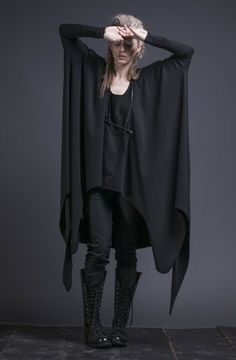 Hel Tunic from the Disir collection by Sisters of the Black Moon. Draped maxi top in slinky jersey. Round neckline. Extra long, slender sleeves. Open bodice. Cropped hemline in front with extra long back and side panels. Raw hemline for fluid movement. $155.