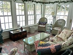 With its off-white furniture and garland of dried flowers, this shabby chic sunroom looks like it belongs in a country cottage. Description from huffingtonpost.com. I searched for this on bing.com/images