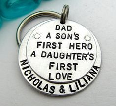 """""""A SONS FIRST HERO A DAUGHTERS FIRST LOVE"""" dad keychain. Hand by FiredUpLadiesHammer, $35.00"""