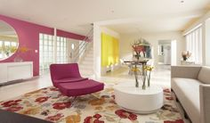 modern living room by Peterssen/Keller Architecture  -i like d touch of pink in the wall