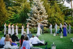 Elegant Garden Wedding. Guest sit on blankets during the ceremony. | Photo credit: Catalina Ayubi catalinaayubi.com