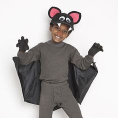 Use a plain black umbrella to create the bat wings for this clever kids' Halloween costume.