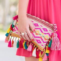 This clutch is hitting all the marks! From the tassels, pop of color, and aztec design. Must have!