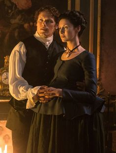 """Starz has released new photos from """"Outlander"""" Season 2, including one of Claire (Caitriona Balfe) and Jamie (Sam Heughan) attending a grand ball at the king's palace. However, th…"""