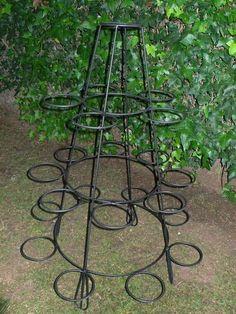 Resultado de imagem para porta maceta de hierro para jardin