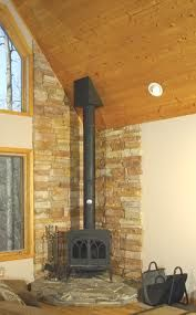 wood stove surround stone…the hubby would love this! wood stove surround stone…the hubby would love this! Corner Fireplace, Wood, Pellet Stove, Wood Stove Fireplace, Hearth, Living Room Wood, Wood Burning Stove Corner, Stove Fireplace, Fireplace