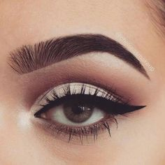 Eye makeup: winged eyeliner, fleeky brows, long lashes and neutral tone eyeshadow