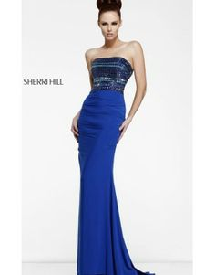 Elegant Sherri Hill 11033. I bought it in gunpowder gray and the fit is amazing!!!!! Can't wait to wear it!!!!!