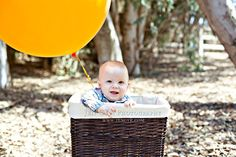 Six month baby boy shoot with a giant balloon! Love six month old babies, great time for a photo shoot because they can't craw away from you yet! #baby poses