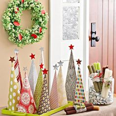 Keep holiday spending under control with these innovative and easy Christmas crafts that spread holiday cheer. We have tons of Christmas projects for you to try, including holiday door decorations and festive table toppers -- all available on a budget! Tabletop Christmas Tree, Handmade Christmas Tree, Noel Christmas, Christmas Projects, Winter Christmas, All Things Christmas, Holiday Crafts, Holiday Fun, Christmas Ornaments