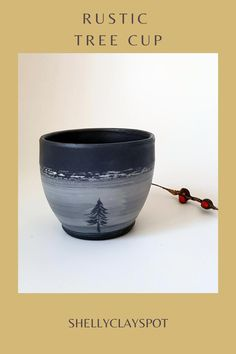 This wheel-thrown cup is made of black stoneware. The rustic mug has a carved tree in the sgraffito technique on top of the porcelain slip. It is glazed with a clear matte glaze. The cup will be wonderful for your morning coffee or hot chocolate on cold days. It's lovely for a cup of tea you can snuggle with :) Imagine a slow easy morning when you enjoy your coffee at the moment and have a good start to a blissful day! #pottery #treecup