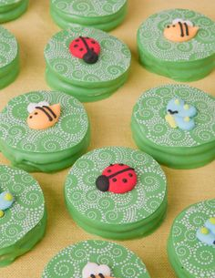 Dipped Oreo decorated cookies using a chocolate transfer sheet and royal icing bugs- bees, ladybug and butterflies