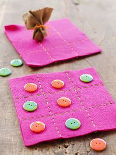 This portable game mat is dressed up with button playing pieces (taking an expedition to choose them can be part of the fun). If you like, make a little bag for them, using a felt circle and a thread or ribbon tie.