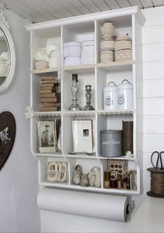 I like the paper roll at the bottom of shelves and the idea of a repainted re-purposed hutch.