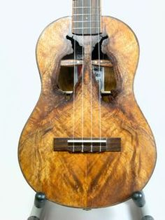 Natural soundholes 4 string ukulele / acoustic guitar family musical instrument with beautiful wood - not Koa but a similar wood grain for this stringed instrument whose carved out natural knots make sound holes. DdO:) MOST POPULAR RE-PINS -  http://www.pinterest.com/DianaDeeOsborne/instruments-for-joy/ - INSTRUMENTS FOR JOY. Lovely photo pinned via Gorney on his great named Pinterest Board GUITAR ART IN MUSIC.