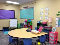 I love this cute and bright second grade classrooms! Love the file crates to with each table's supply caddy and folders!