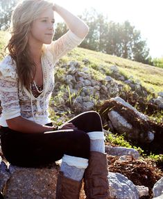 lacy cardigan w/ boots and leg warmers and pearls.